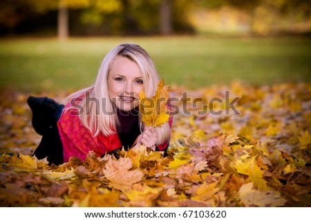 portrait of a young woman in the autumn park