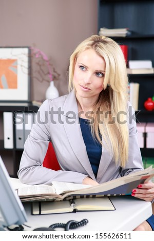 portrait of a young woman in the office