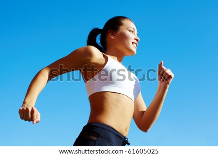 Portrait of a young woman jogging - stock photo