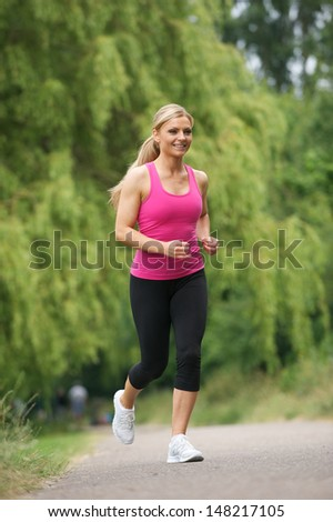 Portrait of a young woman jogging in the park