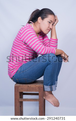 Portrait of a young woman looking bored.