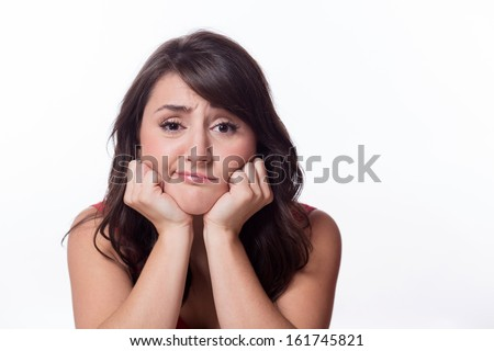 Portrait of a young woman looking bored isolated on a white background - stock photo