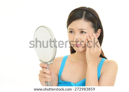 Portrait of a young woman looking depressed - stock photo