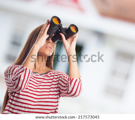 portrait of a young woman looking through a binoculars
