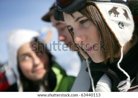 Portrait of a young woman near a group of friends - stock photo