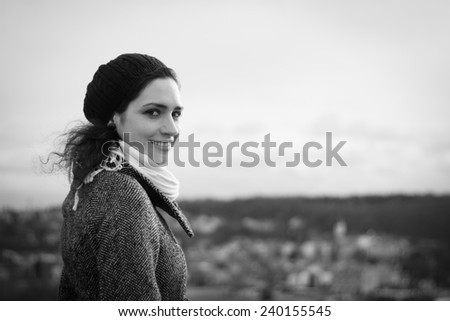 Portrait of a young woman on a winter walk around the city - stock photo