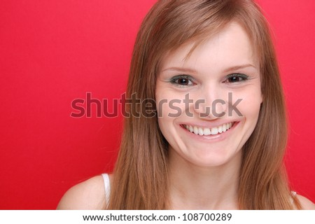 portrait of a young woman on red - stock photo