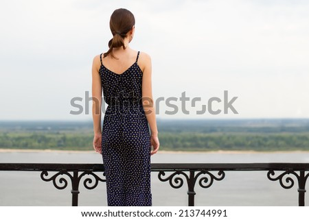 Portrait of a young woman outdoors - stock photo