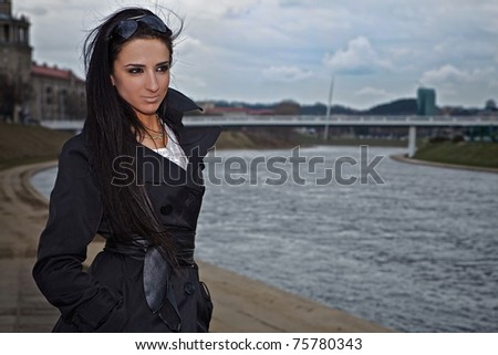 Portrait of a young woman outdoors. - stock photo