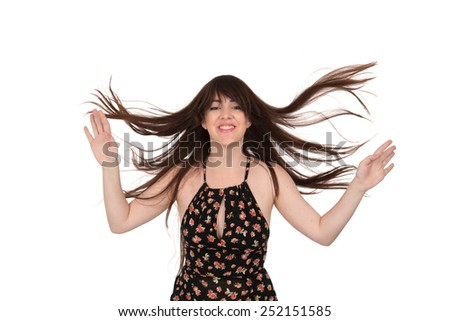 Portrait of a young woman posing with crazy hair against a white background - stock photo