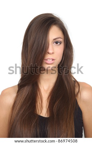 Portrait of a young woman's chest, long hair girl with one eye shut - stock photo