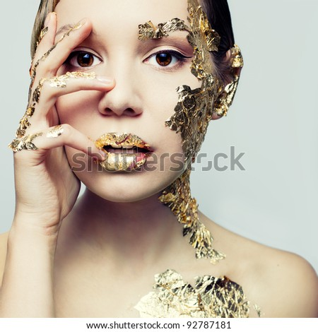 Portrait of a young woman's gold - stock photo