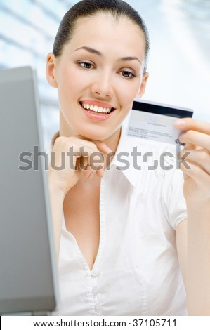 Portrait of a young woman shopping online - stock photo