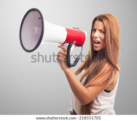 portrait of a young woman shouting with a megaphone