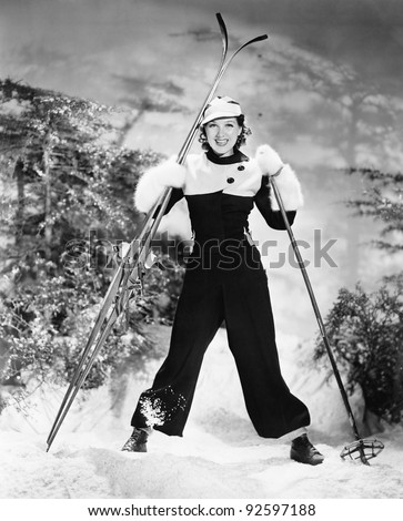 Portrait of a young woman skiing and smiling - stock photo