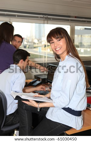 Portrait of a young woman smiling in office