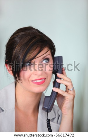 Portrait of a young woman smiling on phone
