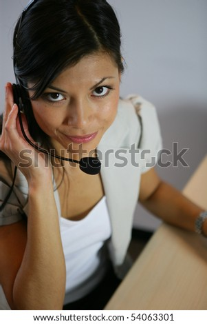Portrait of a young woman smiling with a headset