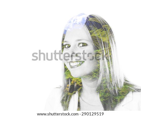 Portrait of a young woman smiling with trees in her hair - stock photo