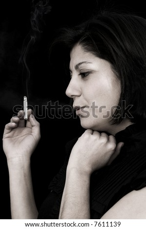 portrait of a young woman smoking in the dark