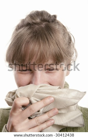Portrait of a young woman sneezing