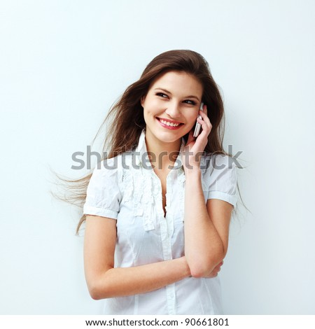 Portrait of a  Young Woman Talking on Mobile Phone - stock photo