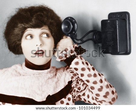 Portrait of a young woman talking on the telephone - stock photo