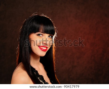 Portrait of a young woman wearing a black dress - stock photo
