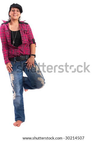 Portrait of a young woman wearing a pink shirt and ripped blue jeans.