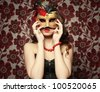 Portrait of a young woman wearing mask - stock photo