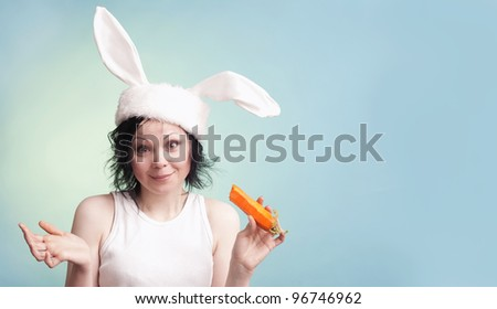Portrait of a young woman wearing rabbit ears. Tonality is added./Funny Portrait - stock photo