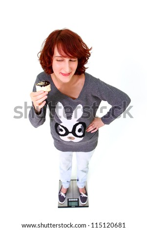 Portrait of a young woman with a cake isolated on white background - stock photo