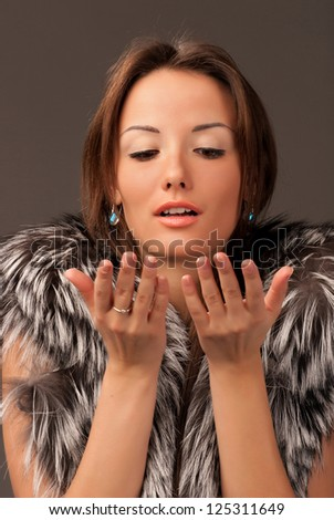 portrait of a young woman with a fur vest