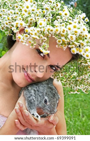 portrait of a young woman with a little bunny - stock photo