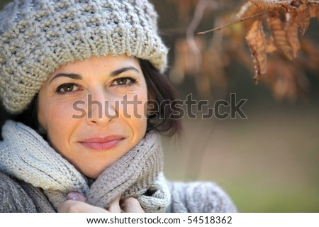 Portrait of a young woman with a wool cap - stock photo