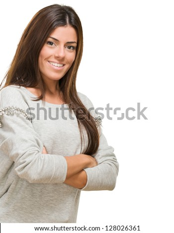 Portrait Of A Young Woman With Arms Folded On White Background