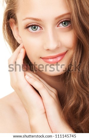 Portrait of a young woman with beautiful blue eyes - stock photo