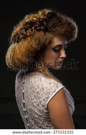 Portrait of a young woman with beautiful hair style in retro style - stock photo