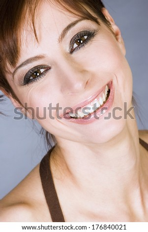Portrait of a young woman with beautiful smile