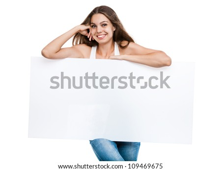 Portrait of a young woman with blank billboard isolated on white background - stock photo