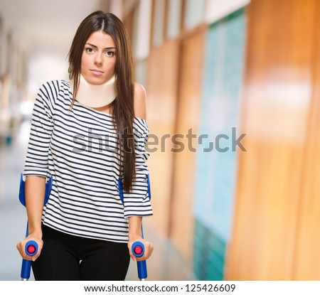 Portrait Of A Young Woman With Crutches, indoor - stock photo