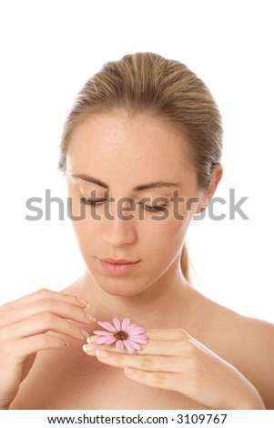 Portrait of a young woman with flower, beauty concept