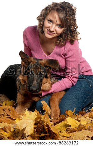 Portrait of a young woman with German Shepherd puppy posing on white - stock photo