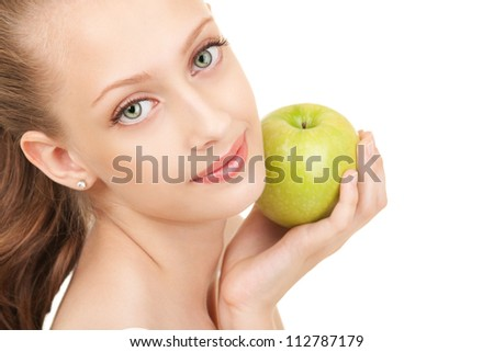 Portrait of a young woman with green apple - stock photo
