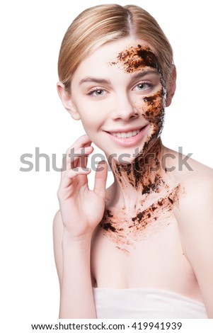 Portrait of a young woman with perfect skin on her face, scrub the skin - stock photo
