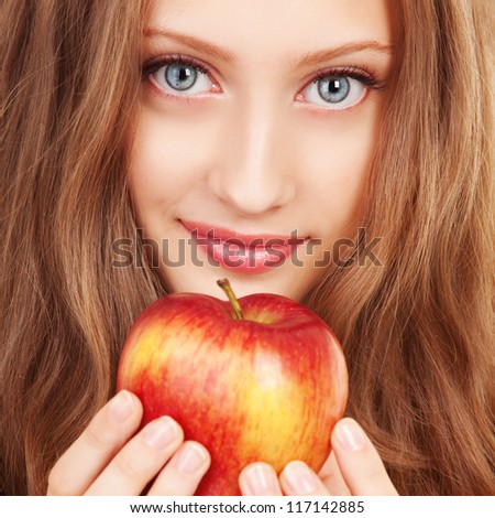 Portrait of a young woman with red apple - stock photo
