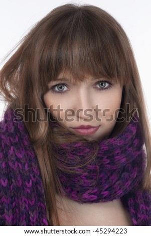 portrait of a young woman with scarf isolated on white