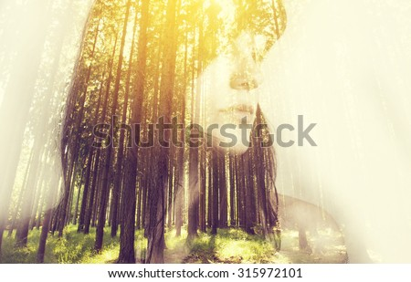 Portrait of a young woman with the effect of double exposure, nature style  - stock photo