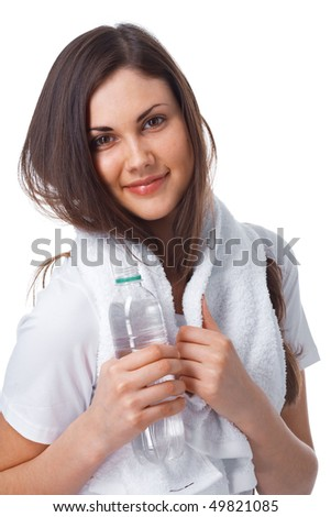 Portrait of a young woman with towel and bottle of water over white - stock photo