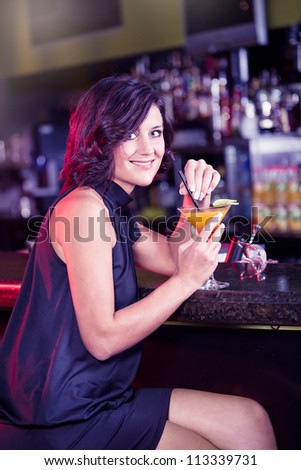 portrait of a young women in the bar - stock photo